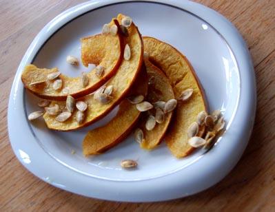 recipe-baked slices of acorn squash brushed with olive oil,salt,garlic ...
