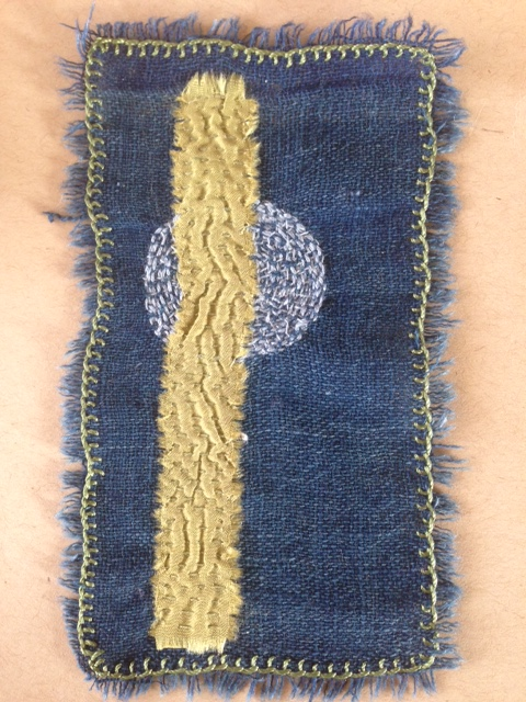 mounted on a card, many tiny stitches on indigo and pommegranate by Therese S-H