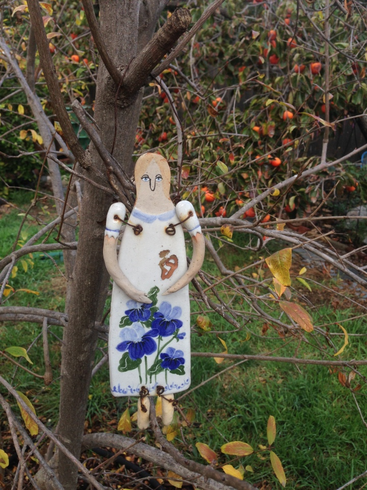 the garden maiden is probably a matron by now- she had been surveying the garden for quite some time. a long-ago gift...